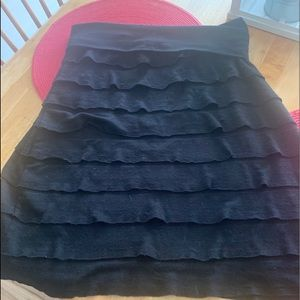 Pull on black skirt with ruffles.